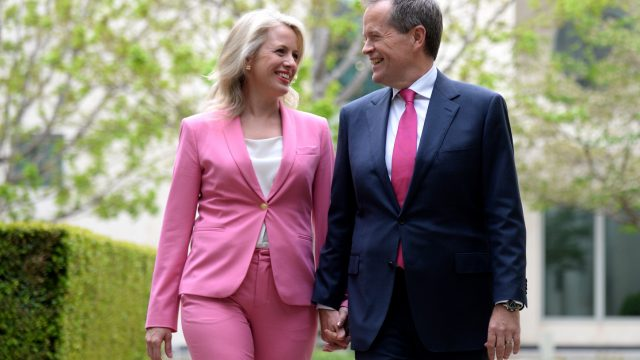 Leader of the Labor party Bill Shorten (right) and his wife Chloe pose for photographs at Parliament House in Canberra, Sunday, Oct. 13, 2013. The Labor party announced Bill Shorten as the newly elected leader. (AAP Image/Lukas Coch) NO ARCHIVING